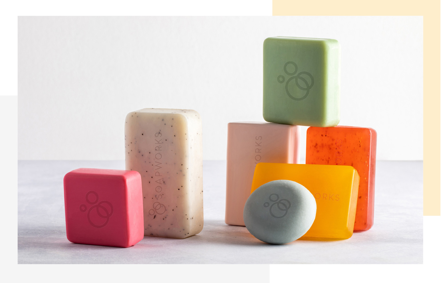 Selection of opaque and translucent soaps in different shapes stacked together