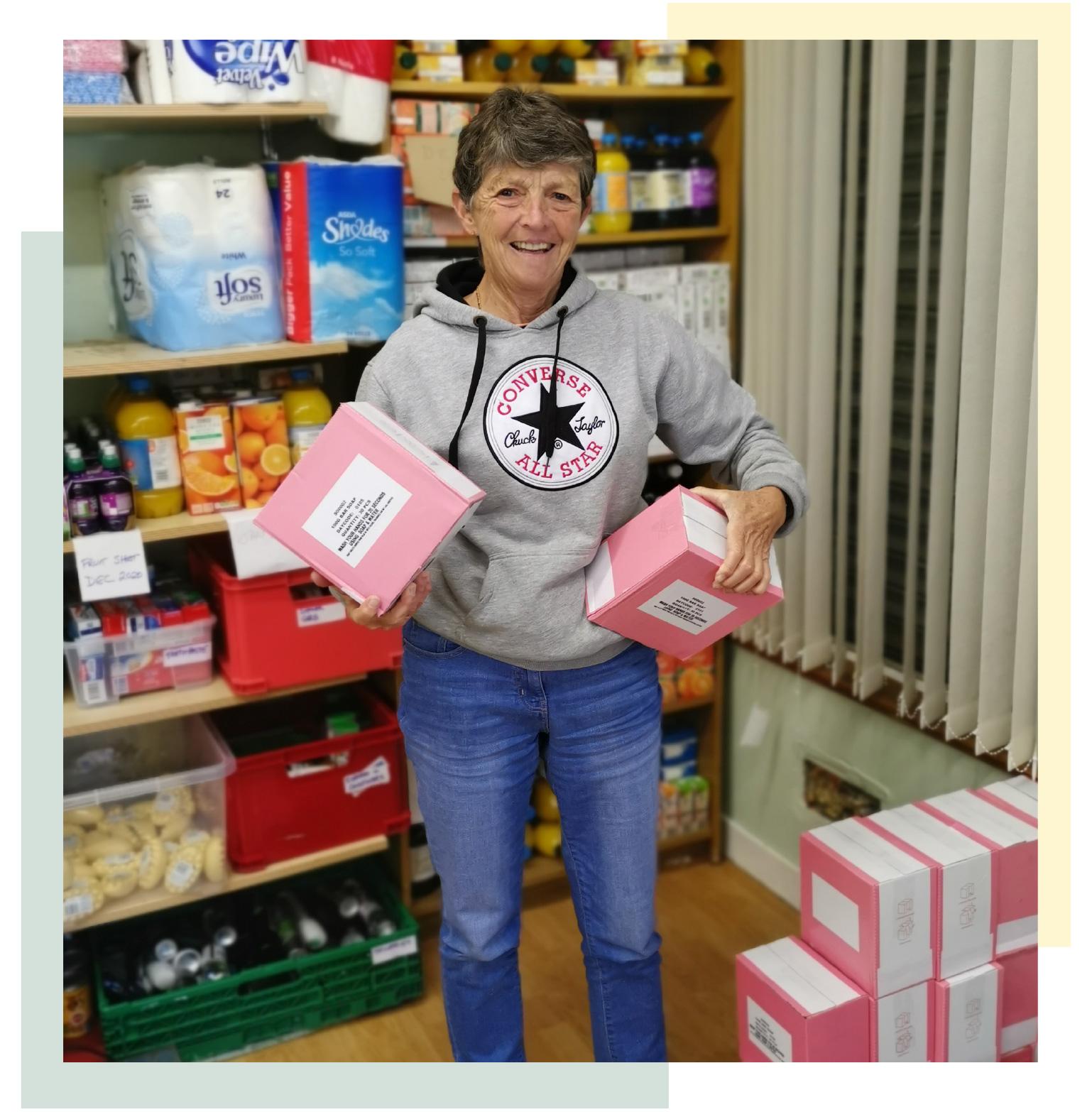 Volunteer receiving soap for local food bank