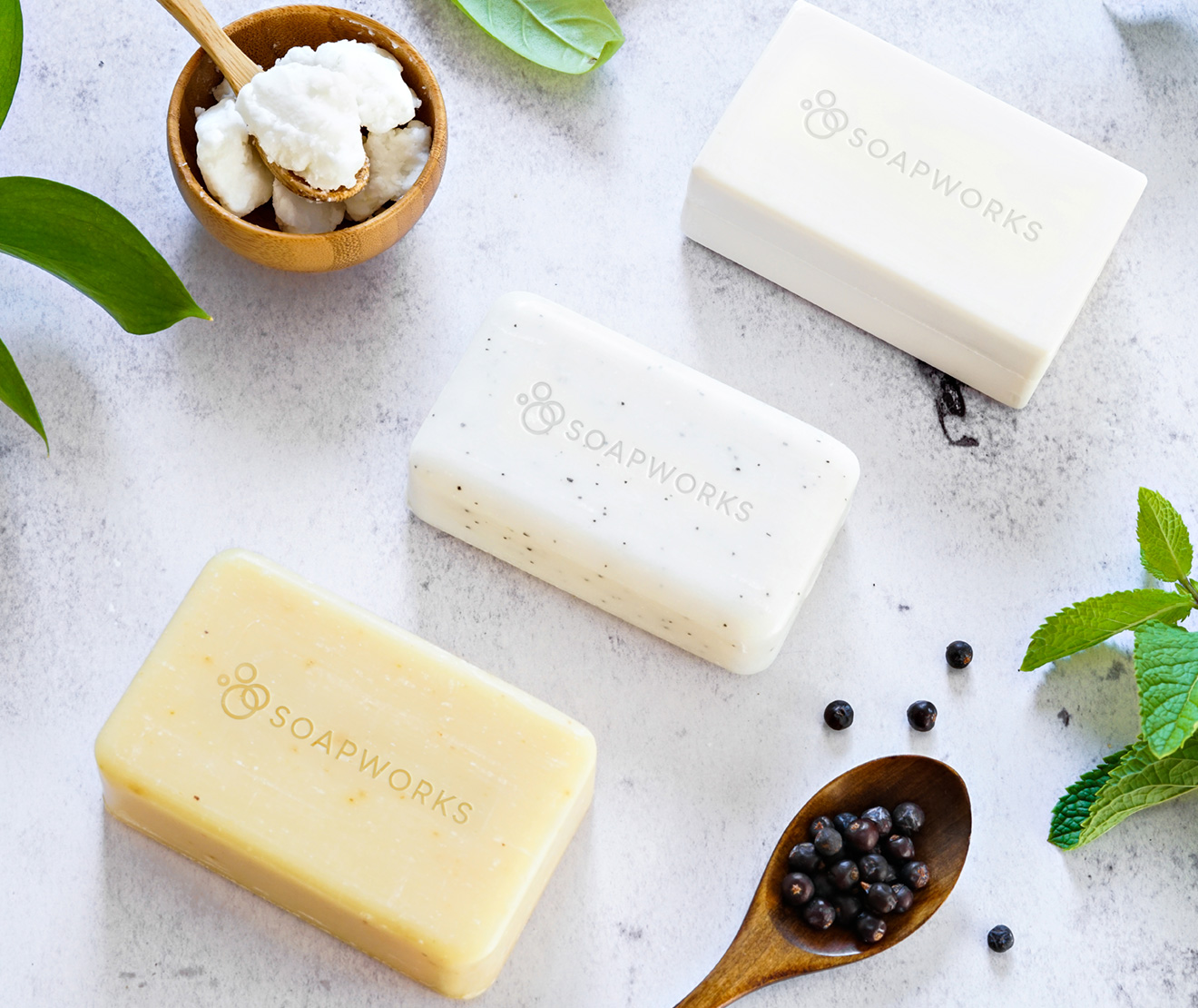 Bar Soaps with natural ingredients on a marble background