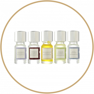 Home fragrance oils with different colour labels on a white background