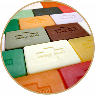 Selection of Soap Aid soaps laid out in rows