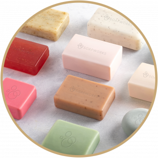 Selection of different coloured soaps laid out flat on a neutral background