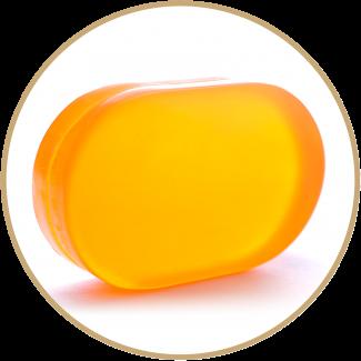 Translucent bar of soap on white background