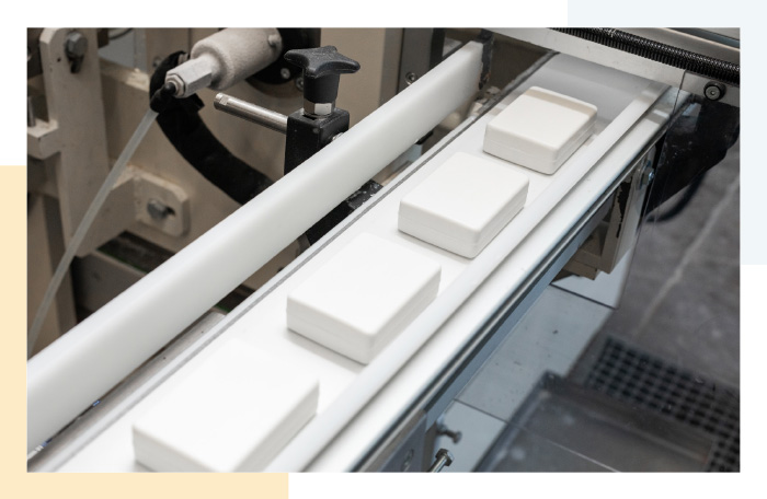 Bar soap coming off the production line onto belt