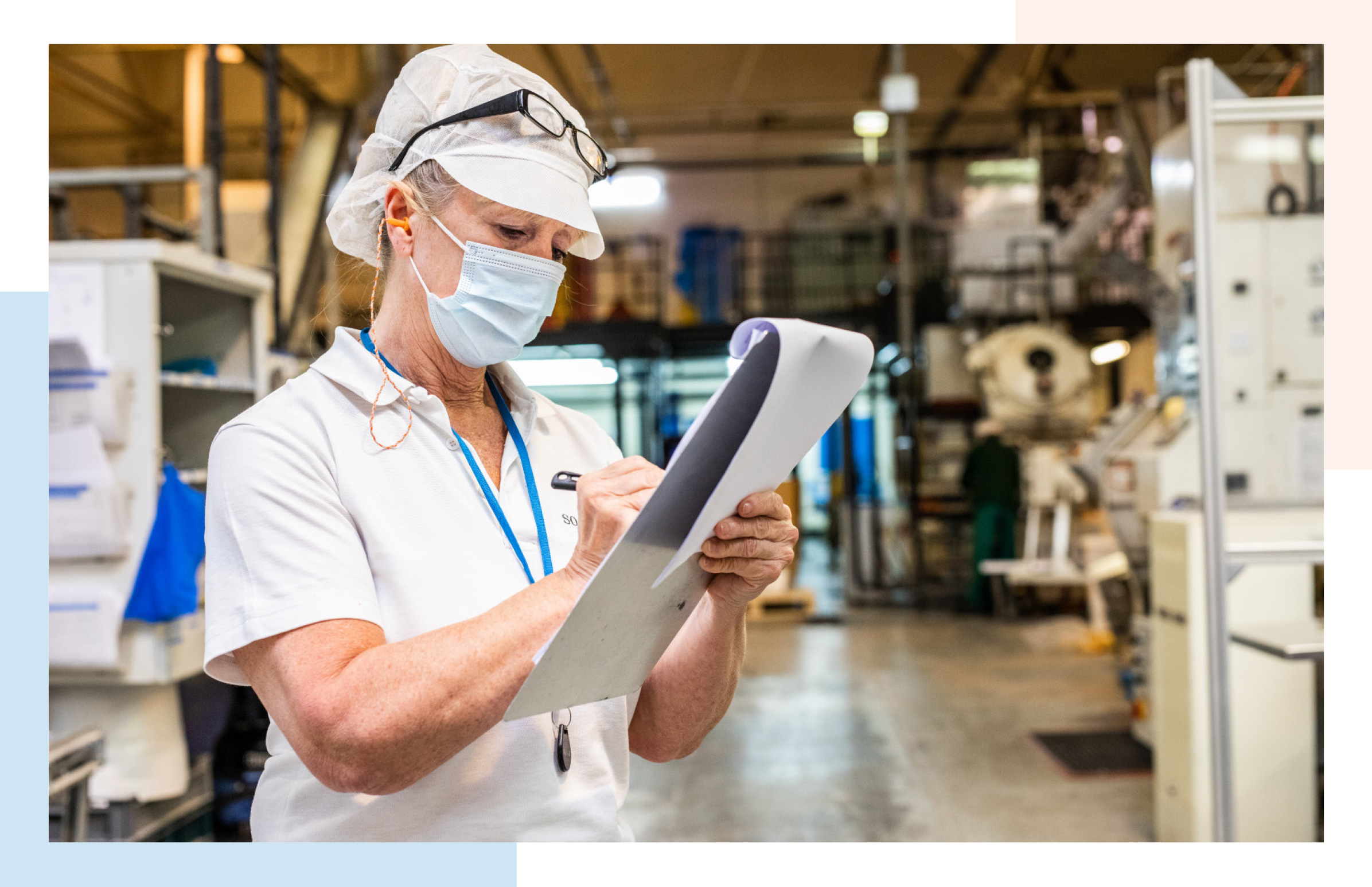Factory Team Leader taking notes at production line
