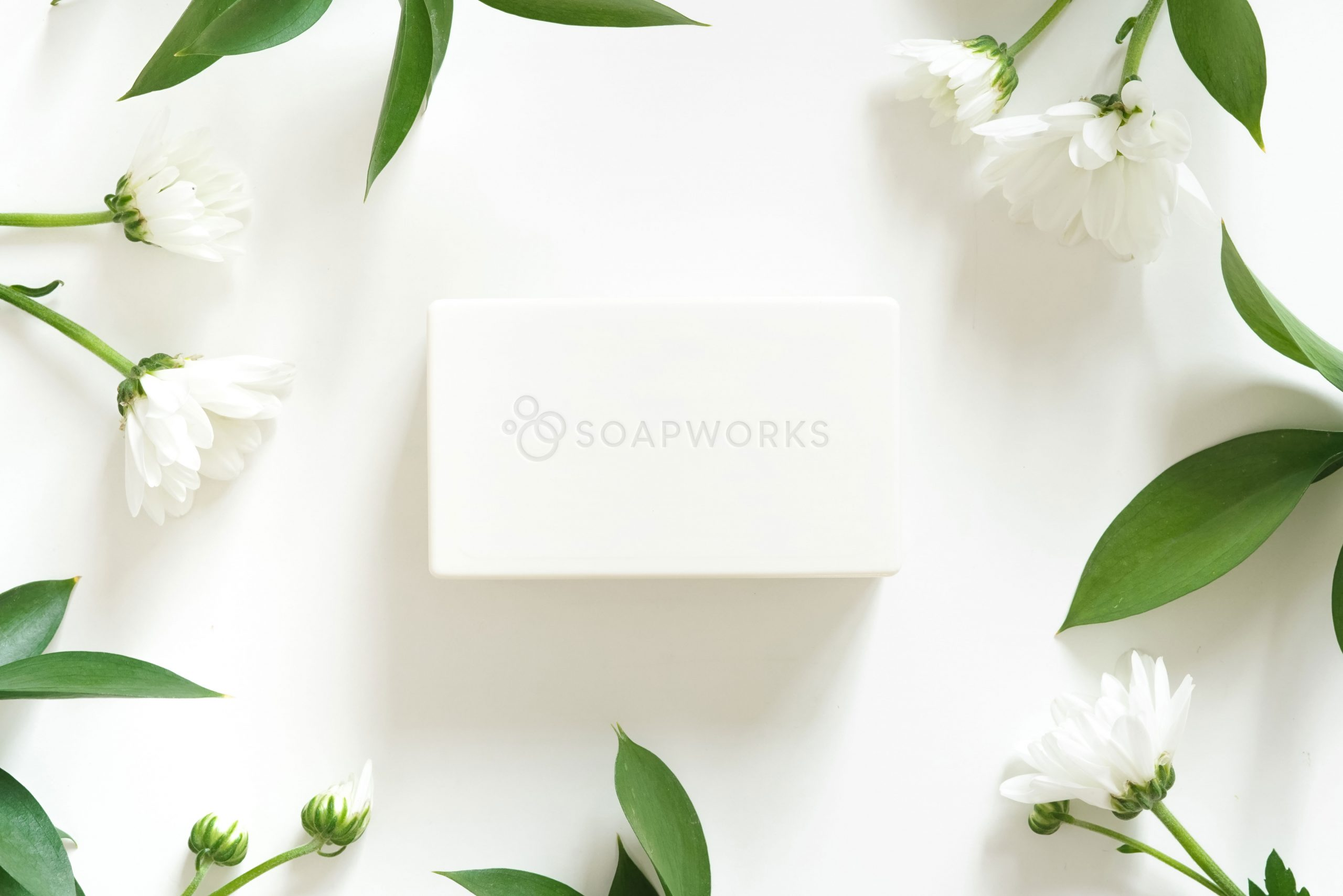 Bar soap with flowers on a white background